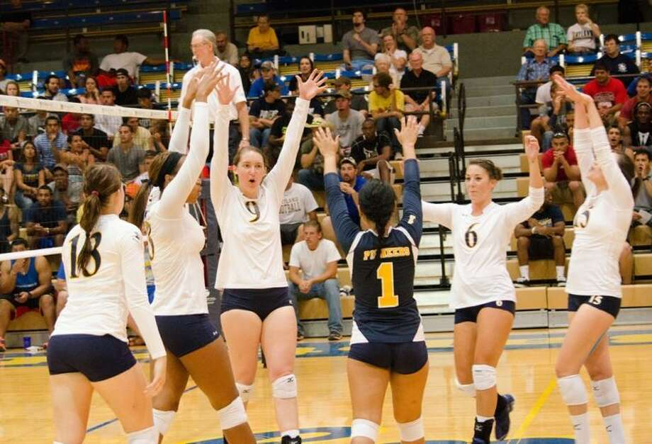 Members of the Wayland Baptist volleyball team celebrate after a block. (From left to right) Cindy Horn, Shahala Hawkins, Claire Jacobsma, Mercades Torres, Ashlyn Westerman, and Grecia Rivera Photo: Calvin Bass/Wayland Baptist University