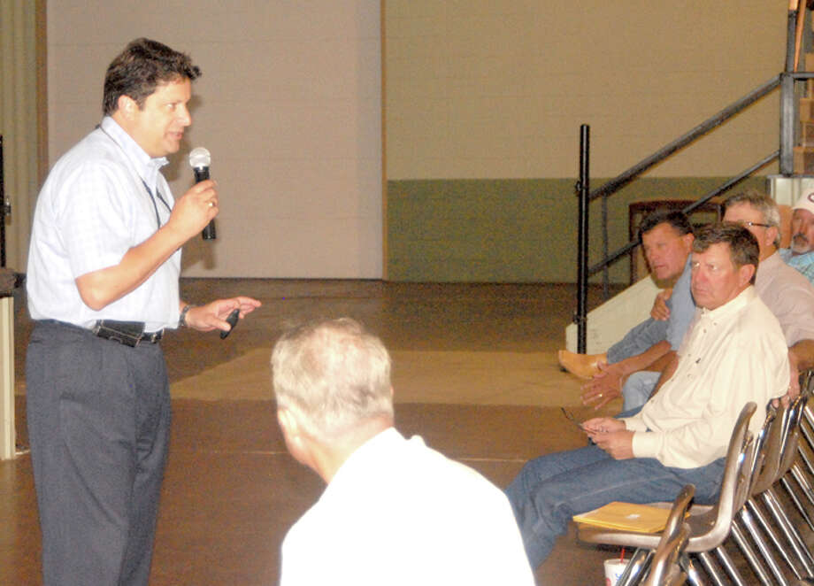 Tom Carbone, president of Tri-Global Energy, addresses landowners and investors during a meeting Monday concerning the newly formed Hale County Energy LLC, which combines Tri-Global's four wind farm projects in Hale County. Photo: Doug McDonough/Plainview Herald