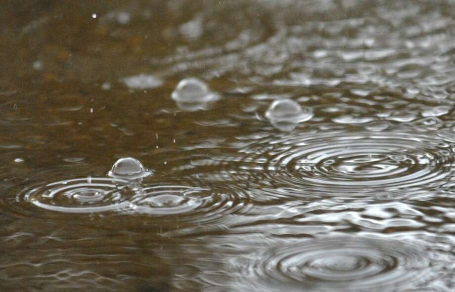 Rain causes bubbles as it pools in streets this morning from a shower that brought 0.09 inches of rain to Plainview.