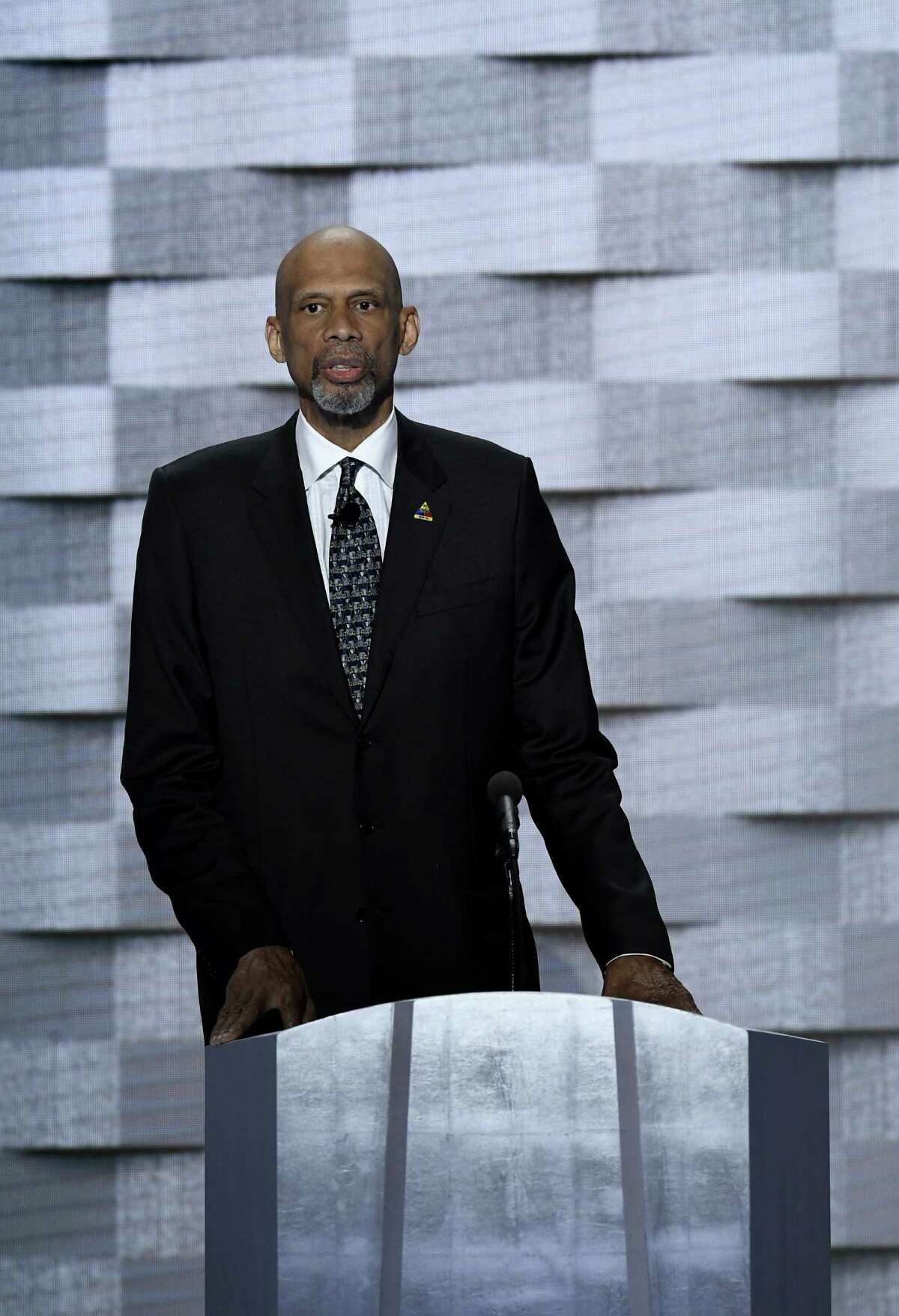 Retired NBA player Kareem Abdul-Jabbar speaks during the Democratic National Convention (DNC) in Philadelphia, Pennsylvania, U.S., on Thursday, July 28, 2016. Division among Democrats has been overcome through speeches from two presidents, another first lady and a vice-president, who raised the stakes for their candidate by warning that her opponent posed an unprecedented threat to American diplomacy. Photographer: David Paul Morris/Bloomberg