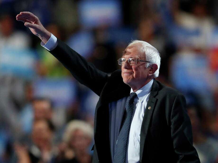 Former Democratic Presidential candidate, Sen. Bernie Sanders, I-Vt., takes the stage during the first day of the Democratic National Convention in Philadelphia , Monday, July 25, 2016. Photo: Paul Sancya, AP / Copyright 2016 The Associated Press. All rights reserved. This material may not be published, broadcast, rewritten or redistribu