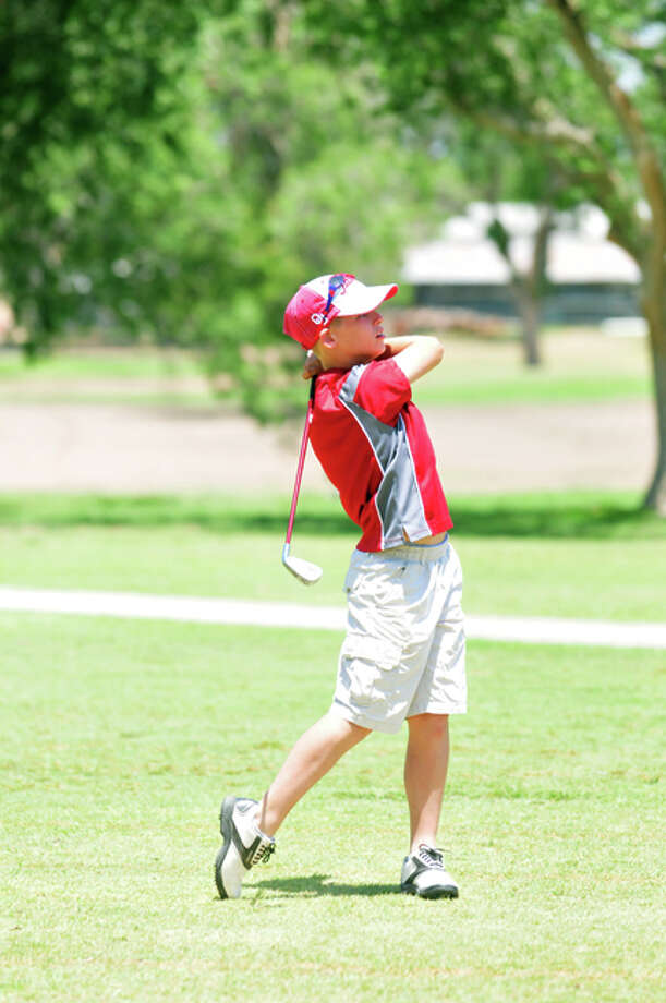Peyton McNutt watches as his shot sails toward the green on the final day of the PHS golf camp. Photo: Summer Morgan/Plainview Herald