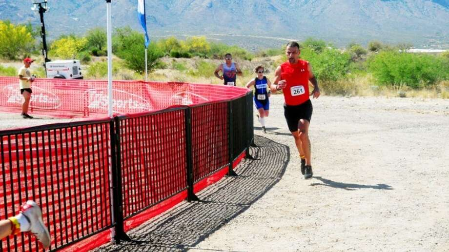 Former Floydada resident Brad Saens takes a corner on the course at the 2012 Duathlon National Championships held April 28 in Tucson, Arizona. Saens finished 18th in his age division, qualifying him for the 2012 ITU World Duathlon Championships in Nancy, France this September. Photo: Courtesy Photo