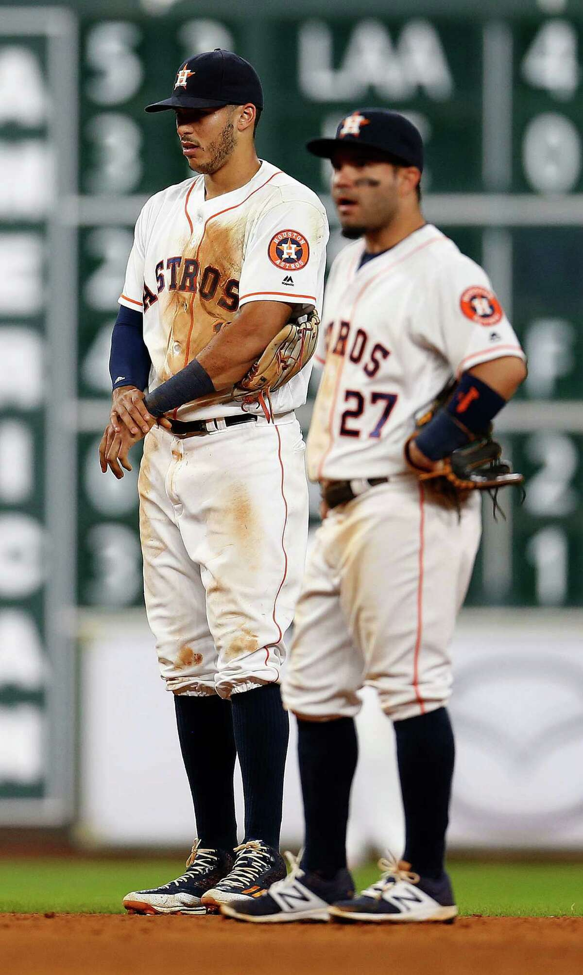 Houston Astros shortstop Carlos Correa (1) holds his wrist after falling on his arm fielding a single by Yankees Carlos Beltran during the ninth inning of an MLB game at Minute Maid Park, Monday, July 25, 2016, in Houston.