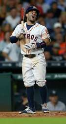 Houston Astros second baseman Jose Altuve (27) reacts to a called strike during his at bat in the eighth inning of an MLB game at Minute Maid Park, Monday, July 25, 2016, in Houston.