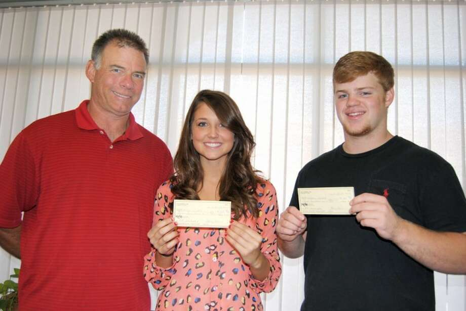 Doug McDonough/Plainview HeraldCity Council PTA President Jack Wirth (left) presents PTA scholarship checks to Plainview High graduating seniors Karley Wells and Andrew Dunlap. Wells plans to major in education at Lubbock Christian University while Dunlap will seek a degree in animal science at Texas Tech. Both received $300 scholarships from the PTA.