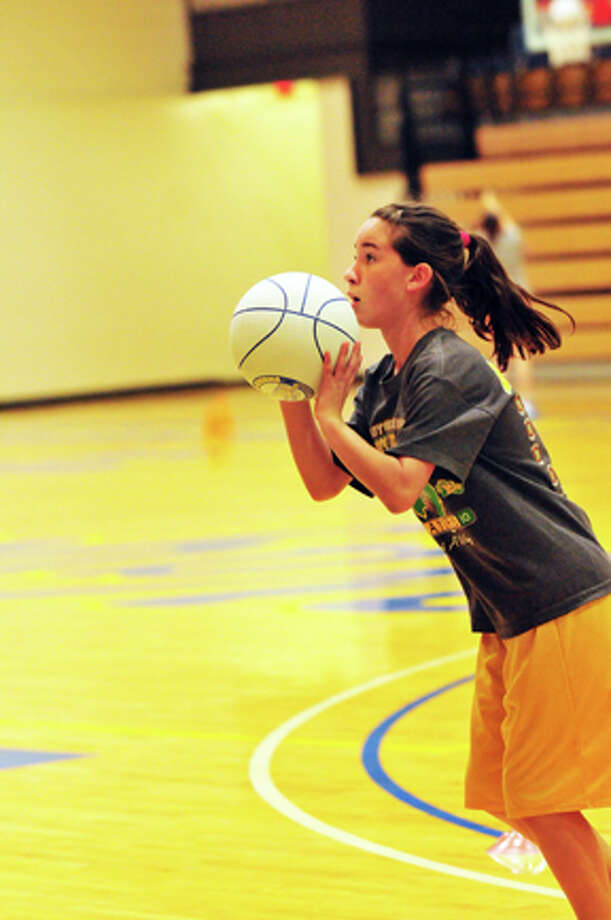 Flying Queens camper Callie Crum participates in a shooting drill Monday at Hutcherson Center. Photo: Summer Morgan/Plainview Herald