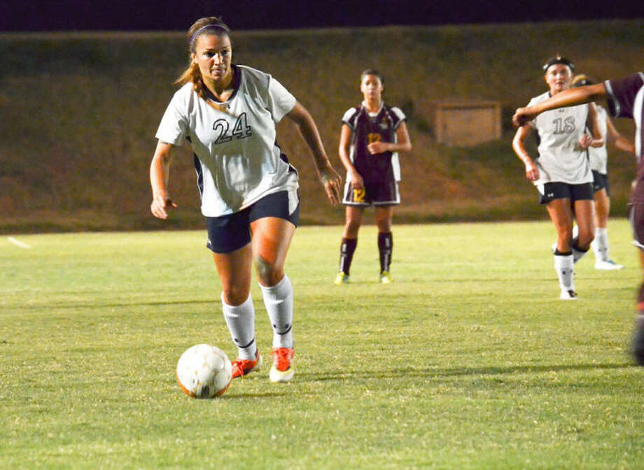 Senior Emarie Holland prepares to shoot against Huston-Tillotson in Friday night's 4-1 victory. Holland had three goals on the night, her second hat trick in as many games. Photo: Calvin Bass/Wayland Baptist University