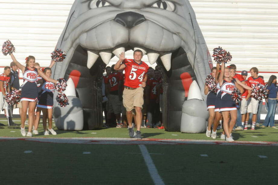 rendan Voss, shown emerging from the inflatable Bulldog at Meet The Bulldogs Night, is one of Plainview's captains and should help the team on both sides of the ball as a center and middle linebacker. Photo: Skip Leon/Plainview Herald