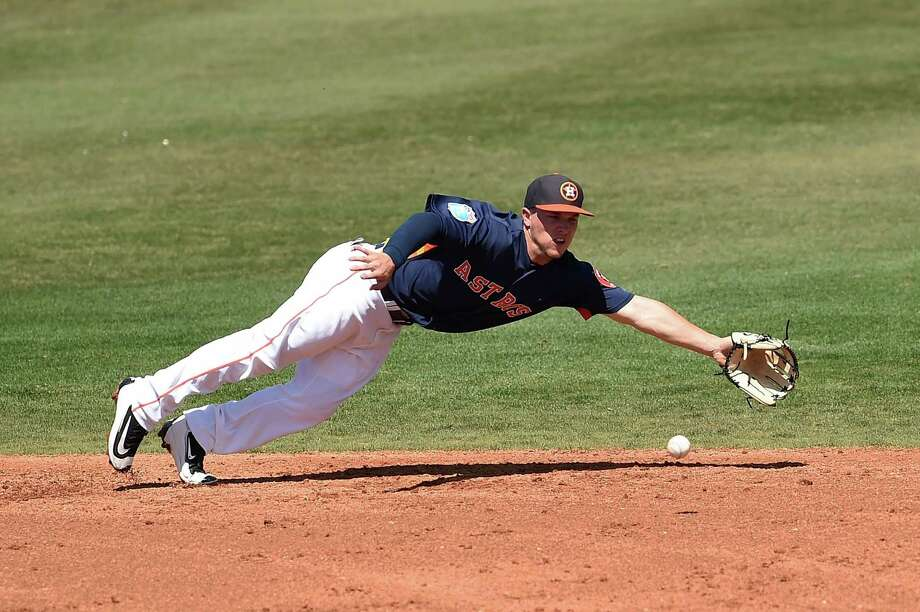 Alex Bregman f the Houston Astros dives for a ground ball during the third inning of a spring training game against the Washington Nationals at Osceola County Stadium on March 15, 2016 in Kissimmee, Florida. Photo: Stacy Revere /Getty Images / 2016 Getty Images