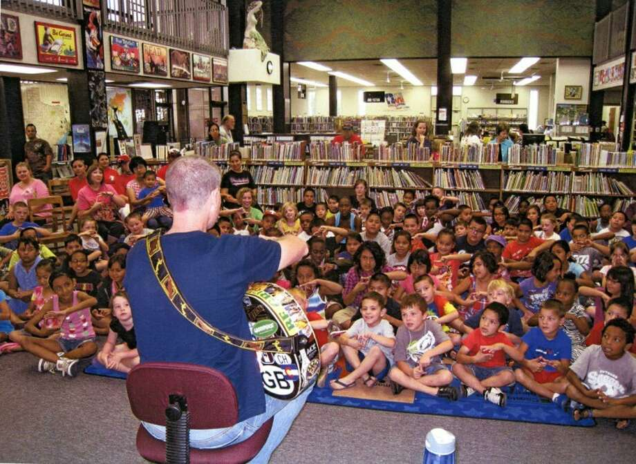 Andy Mason of Portales, N.M., performs to an attentive audience Tuesday for the Texas Reading Club at Unger Memorial Library. The summer reading program continues 10-10:45 a.m. Monday through Friday throughout June. Letti Cheyne will have a program on photography today.