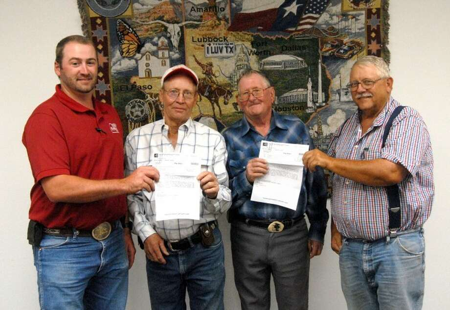 Hale County Farm Bureau representatives Jesse Stambaugh (left) and Weldon Melton (right) present checks for $150 each to Jimmy Goree of the Halfway Volunteer Fire Department and Robert Block of the Edmonson Volunteer Fire Department. The donations were to help with expenses incurred in fighting the recent fire that destroyed the Glen Witten home.Hale County Farm Bureau representatives Jesse Stambaugh (left) and Weldon Melton (right) present checks for $150 each to Jimmy Goree of the Halfway Volunteer Fire Department and Robert Block of the Edmonson Volunteer Fire Department. The donations were to help with expenses incurred in fighting the recent fire that destroyed the Glen Witten home. Photo: Richard Porter/Plainview Herald