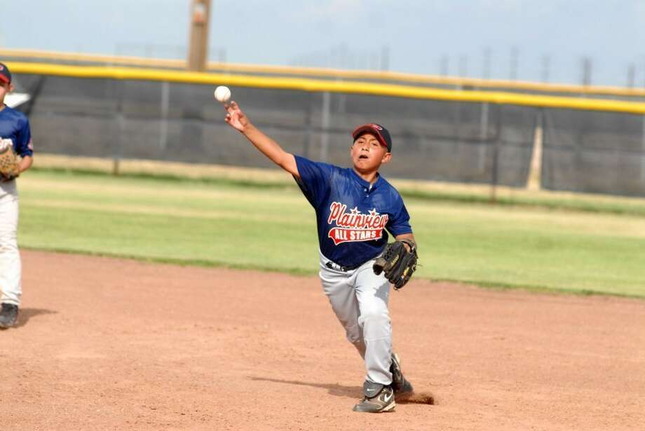 Plainview 12-year-old All-Star second baseman Junior Soliz throws to first during the second inning of Plainview's game against Pampa on Wednesday in Amarillo. Photo: Ryan Thurman/Plainview Herald