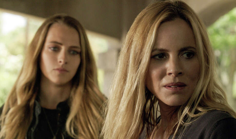 "In this image released by Warner Bros. Pictures,  Teresa Palmer, left, and Maria Bello appear in a scene from the horror film, ""Lights Out."" (Warner Bros. Pictures via AP) ORG XMIT: NYET305 Photo: Warner Bros. Pictures / Warner Bros. Pictures"