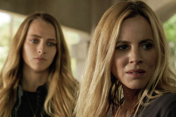 "In this image released by Warner Bros. Pictures,  Teresa Palmer, left, and Maria Bello appear in a scene from the horror film, ""Lights Out."" (Warner Bros. Pictures via AP) ORG XMIT: NYET305"