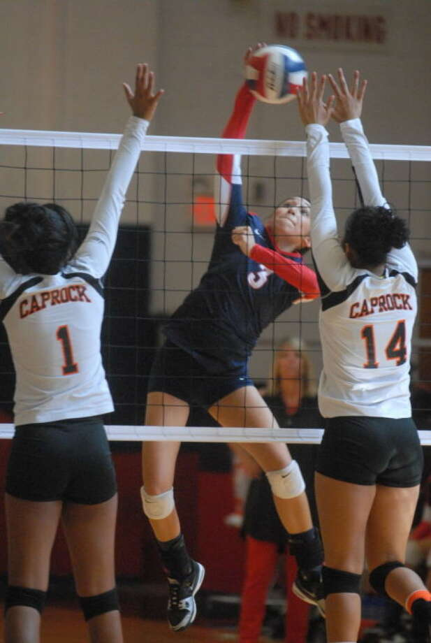 Plainview's Lupita Quintanilla (3) blasts a kill over a Caprock defender during a volleyball match at the Plainview High School gym Saturday. Quintanilla had 24 kills and 21 digs in the five-game loss to the Lady Longhorns. Photo: Skip Leon/Plainview Herald