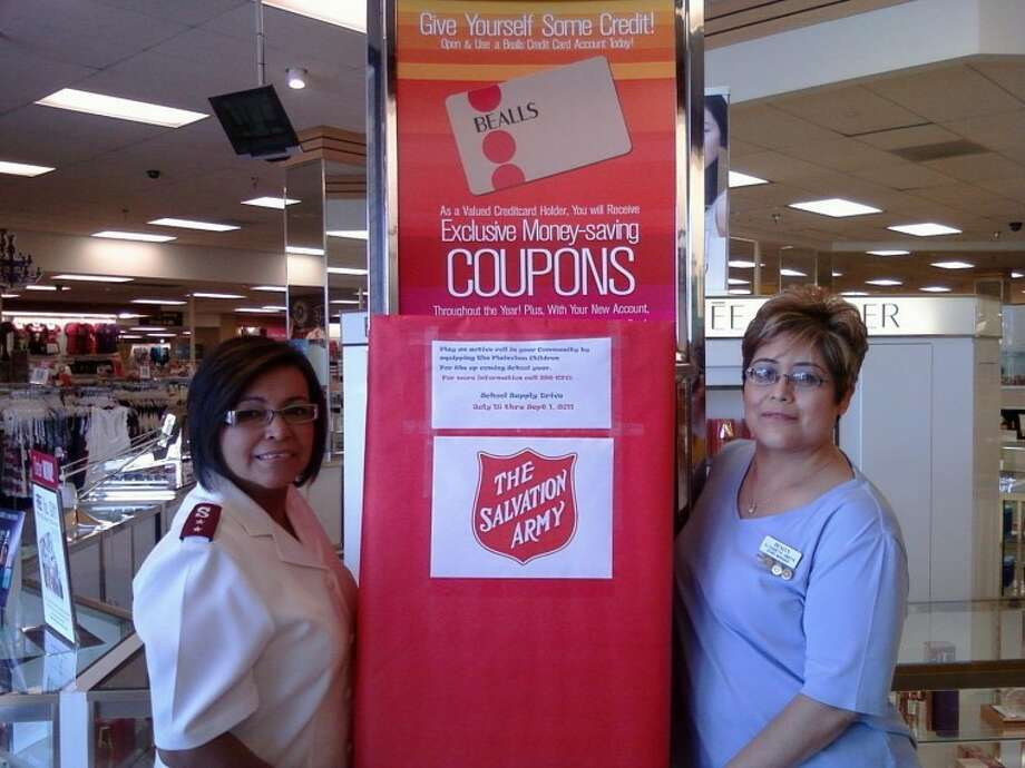 "Salvation Army Capt. Adriana R. Martinez (left) and Elizabeth Amaya, store manager at Bealls, pose with a school supply drop box at the store. The school supplies, which will assist needy kids, will be accepted until Sept. 1. ""All help from our community to help those in need is welcome and needed,"" Martinez said."