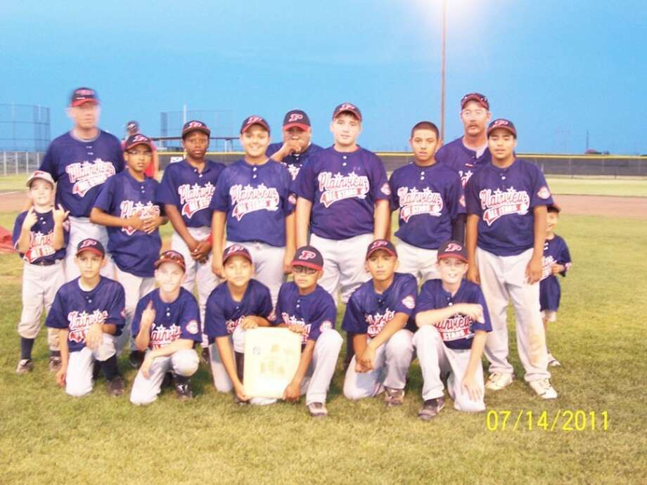 Plainview's 12-year old Cal Ripken American League team playing on 70-foot base paths poses for a team photo after defeating North Randall County in a doubleheader Thursday evening in Amarillo to win the championship and the right to advance to Southwest Regionals this week in Eagle Pass. Pictured are (back, from left): bat boy Dakota Peterson, coach Matt Kelley, Zach Orozco, Patrick Bethea, Taylor Chavez, Santana Soliz, Dillon Johnson, Gabriel Chavez, coach Darrell Peterson, Trendon Jackson; (front) Adrian Gomez, Treyton Peterson, Jerrico Enriquez, Tanis Jackson, Jr. Soliz and Seth Kelley.