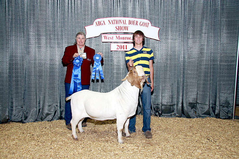 Kelyn King (right) is shown with his 2011 National Reserve Grand Champion Senior Buck at the Junior American Boar Goat Association National Show. He is joined by judge Jackie Edwards. King also was named National Reserve Champion Full Blood Exhibitor and placed in the top seven with nine of the 13 goats he exhibited. Photo: Courtesy Photo