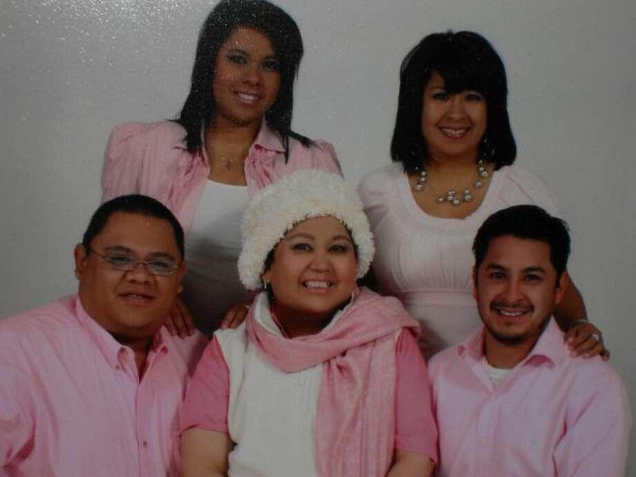 The late Hope Landeros (center) sits with children, clockwise from topp upper left, Melissa Landeros, Monica Hernandez, Robert Landeros and Charles Landeros.