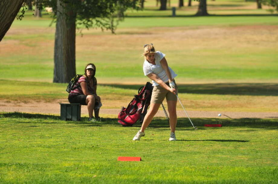 Plainview golfer Colby Snipes connects on a drive during a girls golf match at Plainview Country Club Saturday. Snipes had a good day driving and shot 94 to help her team to a victory in the triangular meet. Photo: Homer Marquez/Plainview Herald