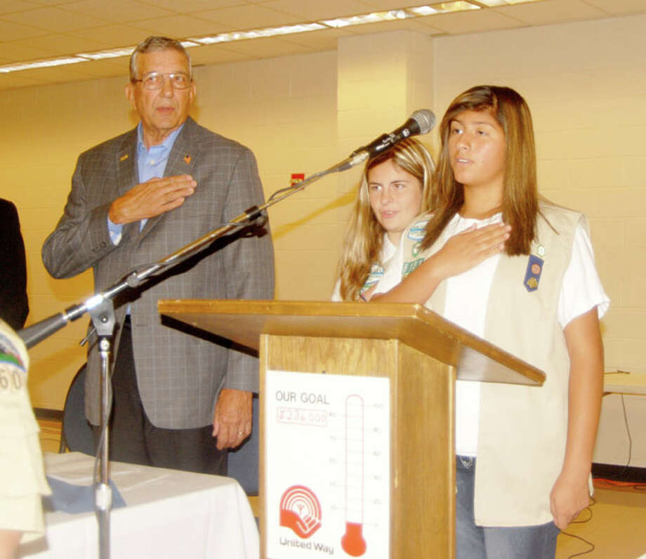 Mayor Wendell Dunlap joins in reciting the Pledge of Allegiance. lead by Plainview Girl Scouts AnnMarie Rushing and Beatrice Rodriguez (right) at Monday's United Way Kickoff Breakfast. This year's goal is $286,000. Photo: Doug McDonough/Plainview Herald