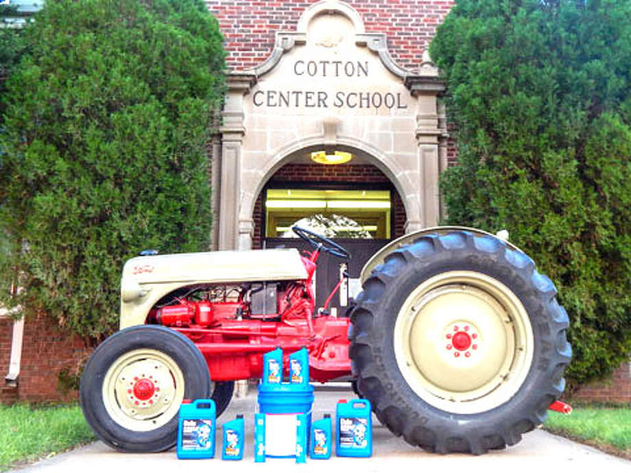 A 1952 Ford 8N tractor, restored by members of the Cotton Center FFA, is parked in front of Cotton Center School. The restored tractor is one of 12 finalists in the 2013 Delo Tractor Restoration Competition. Photo: DeloTractorRestorationCompetition.com Photo