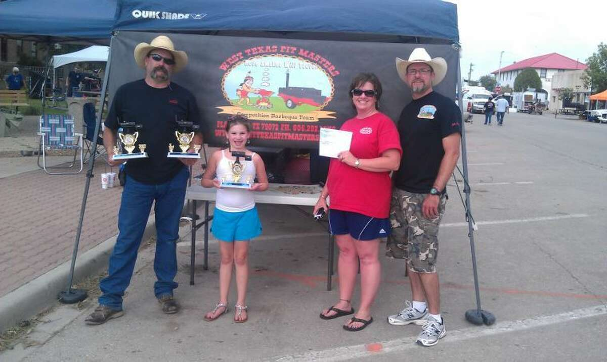 Members of the award-winning West Texas Pit Masters include head cook Lance Moore, daughter Lexi, wife Kristi and brother-in-law Shay Cawphon.