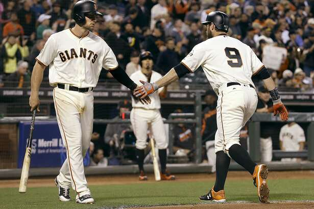 San Francisco Giants' Brandon Belt (9) is congratulated by Conor Gillaspie after hitting a two-run home run against the Cincinnati Reds during the fourth inning of a baseball game in San Francisco, Monday, July 25, 2016. (AP Photo/Jeff Chiu)