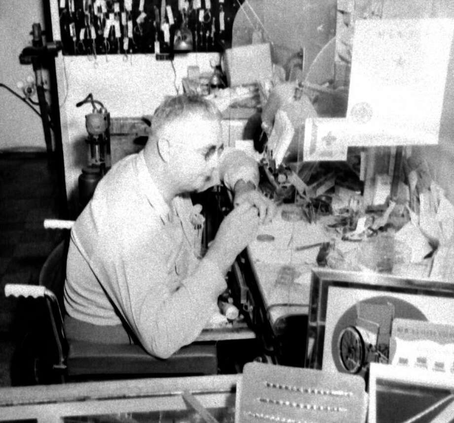 Plainview jeweler Travis Edwards catches up with some watch repair before departing for the 1953 national convention of the Indoor Sports Club in San Francisco. Edwards, who was wheelchair-bound after contracting polio, was second vice president of the Plainview chapter and executive secretary of the 8th District, covering Texas and Louisiana. Photo: Herald File Photo