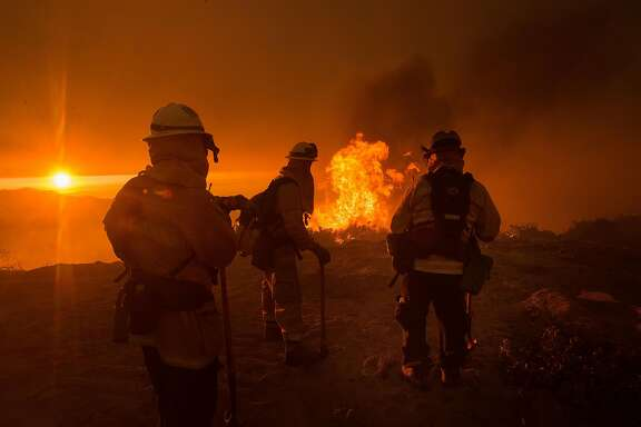 Firefighters battle the Soberane Fire as it jumps a containment line in Carmel Highlands, Calif., on Monday, July 25, 2016.