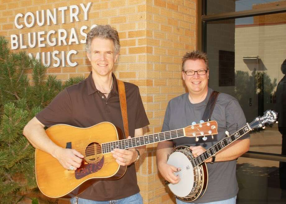 Guitarist Chris Jones (left) and Ned Luberecki share their musical talents with students at the 2011 Camp Bluegrass at South Plains College. Jones and Luberecki are members of the band Chris Jones and the Nightriders. The two also are disc jockeys on SiriusXM Satellite Radio's Bluegrass Junction Channel 61. They will be broadcasting from Levelland during the week from the camp. This marks the 25th year for Camp Bluegrass. Photo: Wes Underwood South Plains College