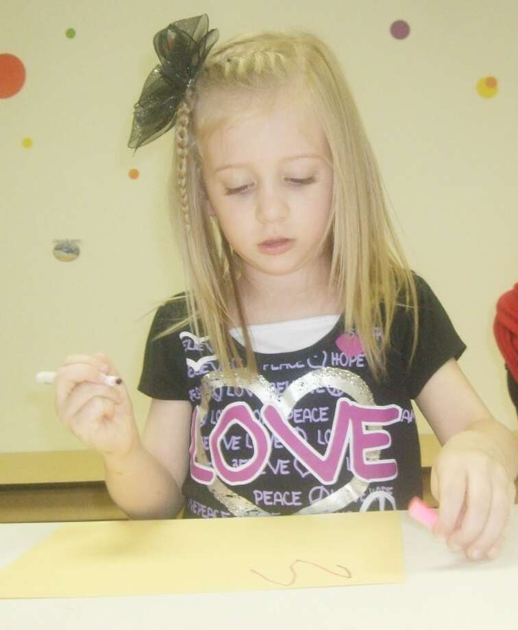 Jessica Thornton/Plainview HeraldMarleigh Styne, daughter of Chris and Janelle Styne, draws her name during crafts at First Baptist Church Vacation Bible School on Tuesday. Approximately 250 children, from age 4 through sixth grade, participated.