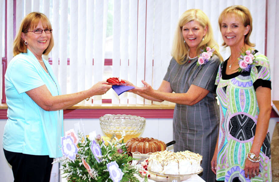 Jan Seago/Plainview ISDPlainview ISD secretary Rhonda Williams (left) serves cake to retiring educators Lisa Kersh and Pam McMahan at a reception last week to honor the pair who will retire at the end of June. Kersh, director of curriculum and instruction, is retiring after 34 years in public education. She will become a professional service provider with Texas Education Agency. McMahan, director of special education, is retiring after 31 years in public education.