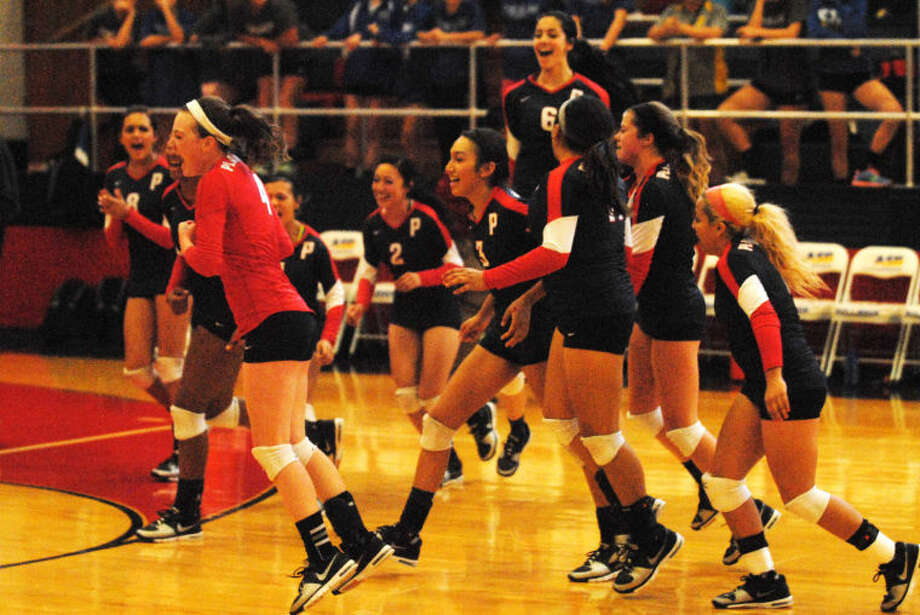 The Plainview Lady Bulldogs volleyball team celebrates after rebounding from two games down to defeat Frenship in the opening District 4-4A match of the season at the PHS gym Saturday. Photo: Skip Leon/Plainview Herald