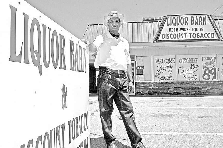 Gordon Zeigler/Plainview HeraldHarry Kotaiya of Plainview stands outside his newly-opened business, Liquor Barn, at Sixth and Hale in Tulia, as he prepares to celebrate its grand opening and ribbon cutting Friday. To mark the occasion, Liquor Barn held a drawing for an LCD television and served customers a free lunch. Kotaya operates Liquor Loft and Comfort Suites in Plainview and is the second specialty liquor firm to open in Tulia since residents recently approved package sales.