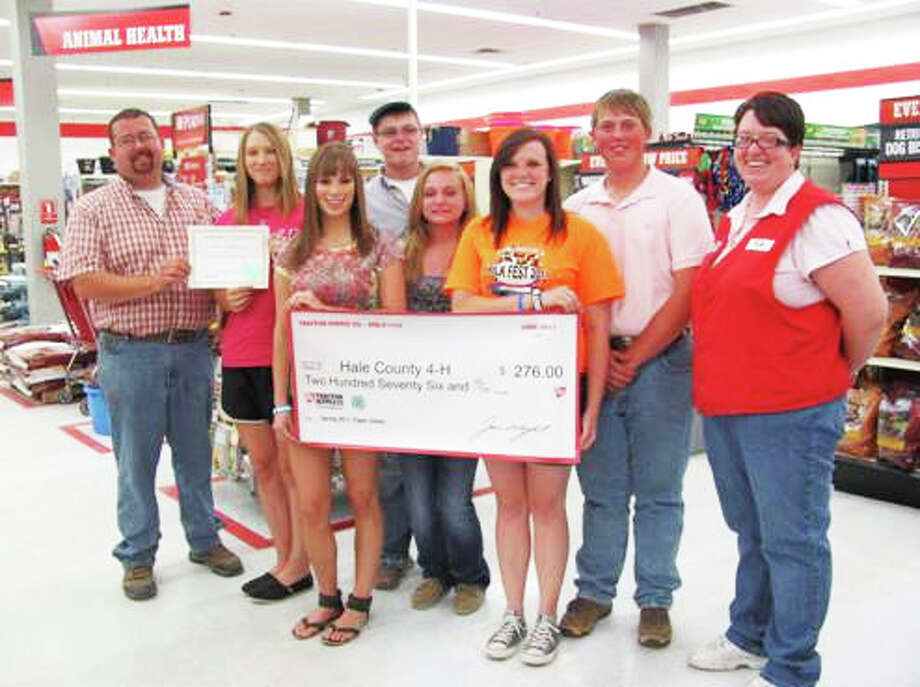 Hale County 4-H presents a certificate of recognition to the Plainview Tractor Supply Company store for having the highest percentage of 4-H Paper Clover donations in its region and supporting the organization's national 4-H Paper Clover Fundraising Program. The funds were donated by store customers in cooperation with the National 4-H Council from March 26 through April 18. For every $1 donation, shoppers receive a paper clover to sign and post in store windows. Pictured with store manager Jeremy Humphrey (left) and assistant manager Kyla Gandy (right) are 4-H members Letti Cheyne, Kristen True, Shelby Maresca, Layne Mustian, Logan Mustian and Layton Schur.