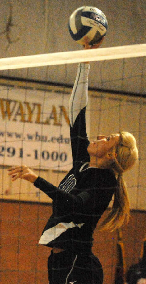 Plainview Christian Academy's Meredith Mulliken tips the ball over the net during a volleyball match earlier this season. Mulliken had a team-high 10 kills against the Bushland junior varsity team Saturday. The Lady Eagles open their district season today in Lubbock. Photo: Skip Leon/Plainview Herald