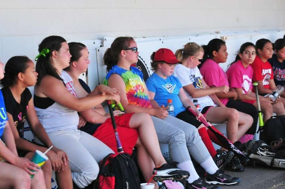 Plainview High softball campers take a water break Thursday in the dugout at Lady Bulldog Park. This year's camp was led by former PHS assistant coach Mike Stephenson, who is now an assistant football coach at Wayland Baptist. Photo: Summer Morgan/Plainview Herald