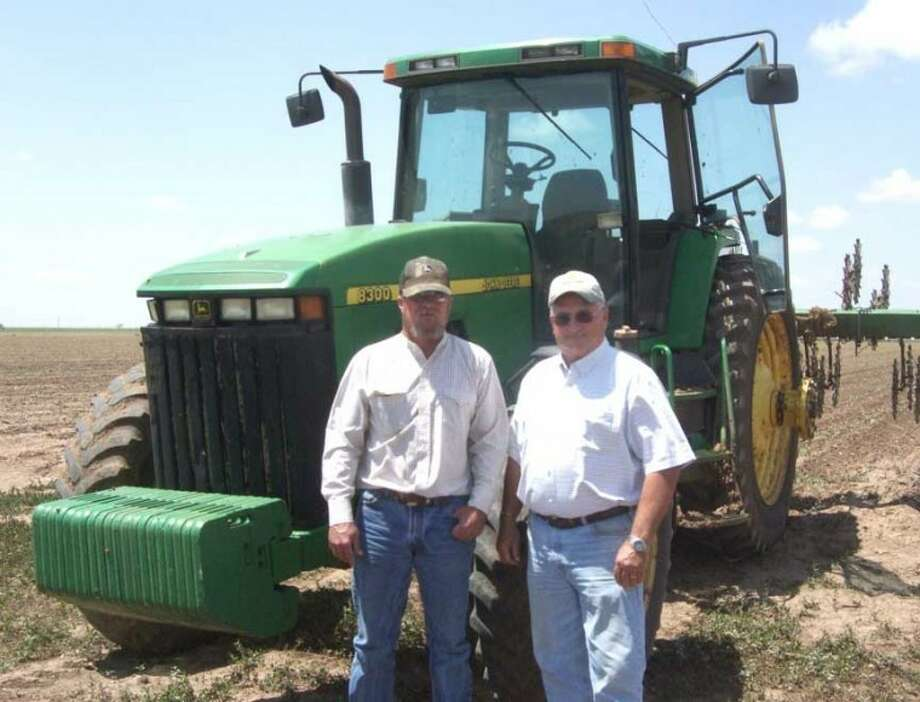 Shanna Sissom/Plainview HeraldFather and son farming team Scott Buchanan (left) and his dad Mike take a break in their fields east of Plainview on Friday. The two plan on spending the better part of Father's Day doing what they love, aboard a John Deere tractor.