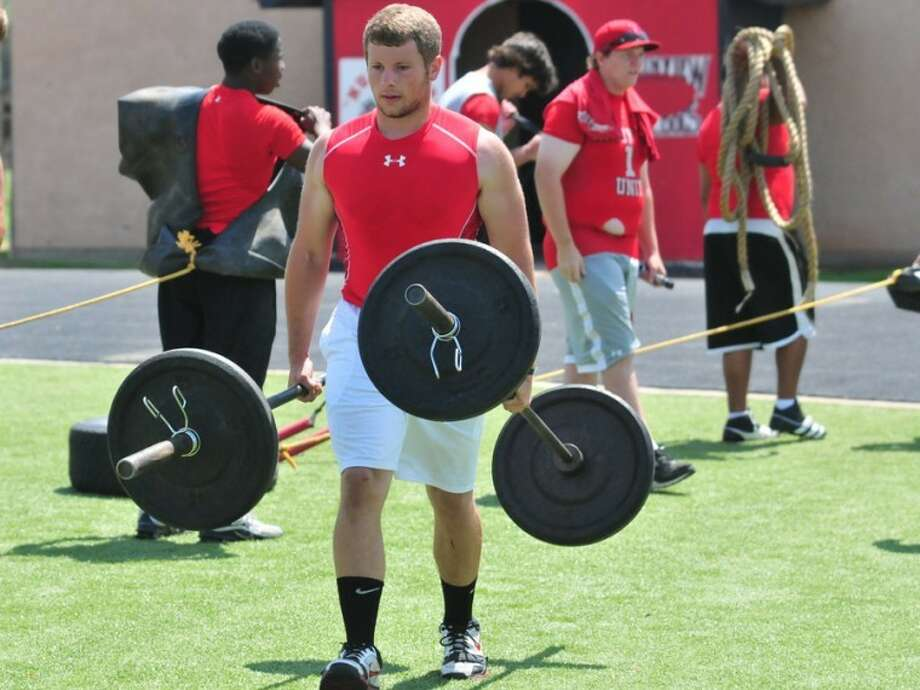 Area football players traveled to Bulldog Stadium Saturday to compete in the 3rd annual PHS Linemen's Challenge. Above, Brendan Voss carries 270 pounds to the finish line. Photo: Homer Marquez/Plainview Herald
