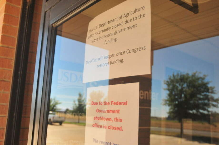 Above signs were placed on the locked doors of Plainview USDA building. Photo: Homer Marquez/Plainview Herald
