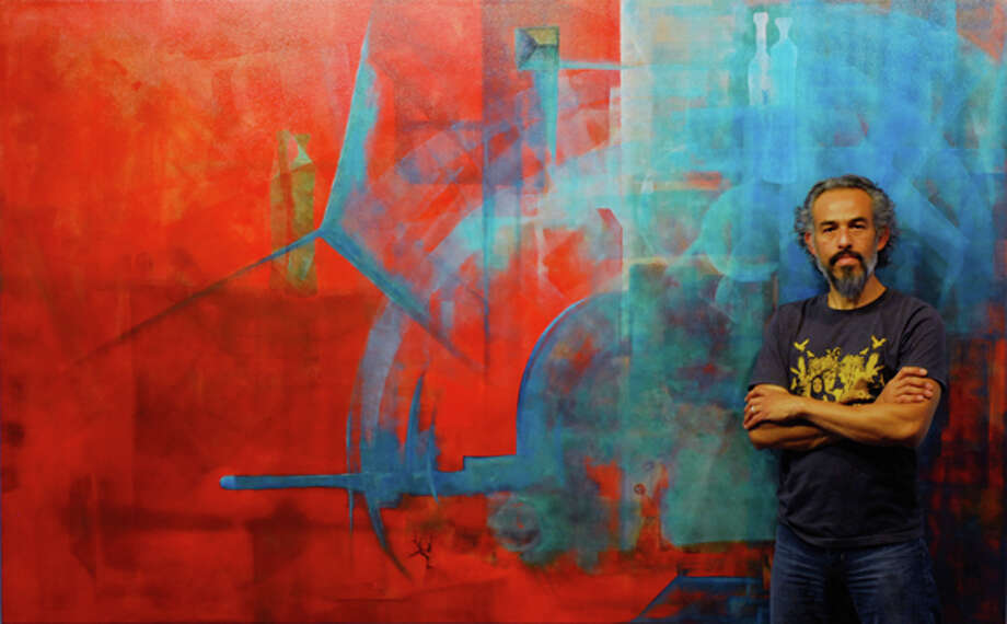 Rafael J. Cañizares-Yunez stands beside his creation, Artist Mediation Meditation X — Blue Koan, 2013, acrylic on canvas, 63 x 102 in., Amarillo, Texas, September 2013. He will present his works at the regular meeting of Plains Art Association at 7 p.m. Monday in St. Mark's Episcopal Church Parish Hall. Photo: Photo Courtesy Plains Art Association / Rafael J. Cañizares-Yunez