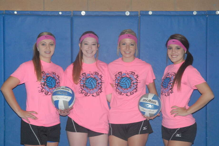 Plainview Christian Academy senior volleyball players (from left) Hannah Smith, Jennifer Cummins, Meredith Mulliken and Madison Ortega display pink uniform shirts they will wear for their match Tuesday night for Breast Cancer Awareness Month. Photo: Skip Leon/Plainview Herald