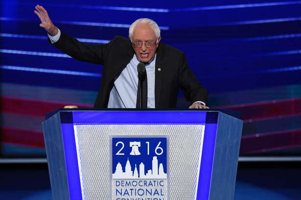 Vermont Senator and former Democratic presidential candidate Bernie Sanders addresses the Democratic National Convention at the Wells Fargo Center in Philadelphia, Pennsylvania, July 25, 2016. Vanquished White House hopeful Bernie Sanders told a riven and lively Democratic convention that his rival Hillary Clinton must win the US presidential election in November / AFP PHOTO / SAUL LOEBSAUL LOEB/AFP/Getty Images