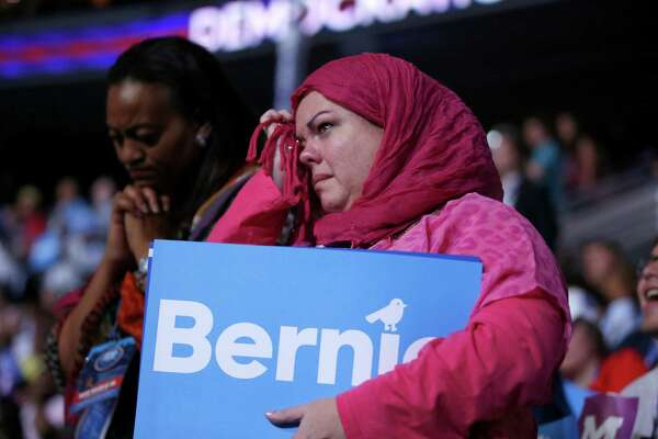 Ohio delegates Cynthia Cox deBoutinkhar, right, cries as Former Democratic Presidential candidate, Sen. Bernie Sanders, I-Vt., speaks during the first day of the Democratic National Convention in Philadelphia , Monday, July 25, 2016.