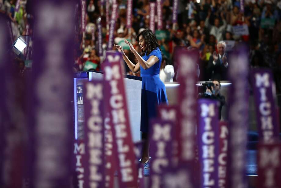 U.S. First Lady Michelle Obama waves while speaking during the Democratic National Convention (DNC) in Philadelphia, Pennsylvania, U.S., on Monday, July 25, 2016. The Democratic National Committee gloated as Republicans struggled to project unity during the party's national convention, but they are now facing a similar problem after their leader resigned on the eve of their own gathering. Photographer: Andrew Harrer/Bloomberg Photo: Andrew Harrer, Bloomberg