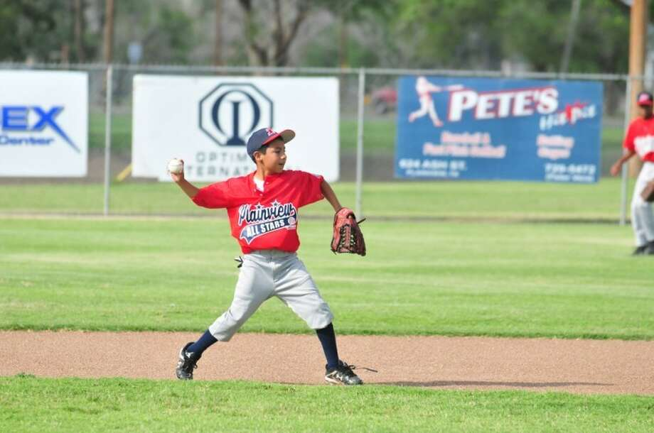 All-star Josh Castillo fields a grounder at practice Thursday as the 11-12 year-old Cal Ripken team prepares to host a tournament today. Photo: Homer Marquez/Plainview Herald