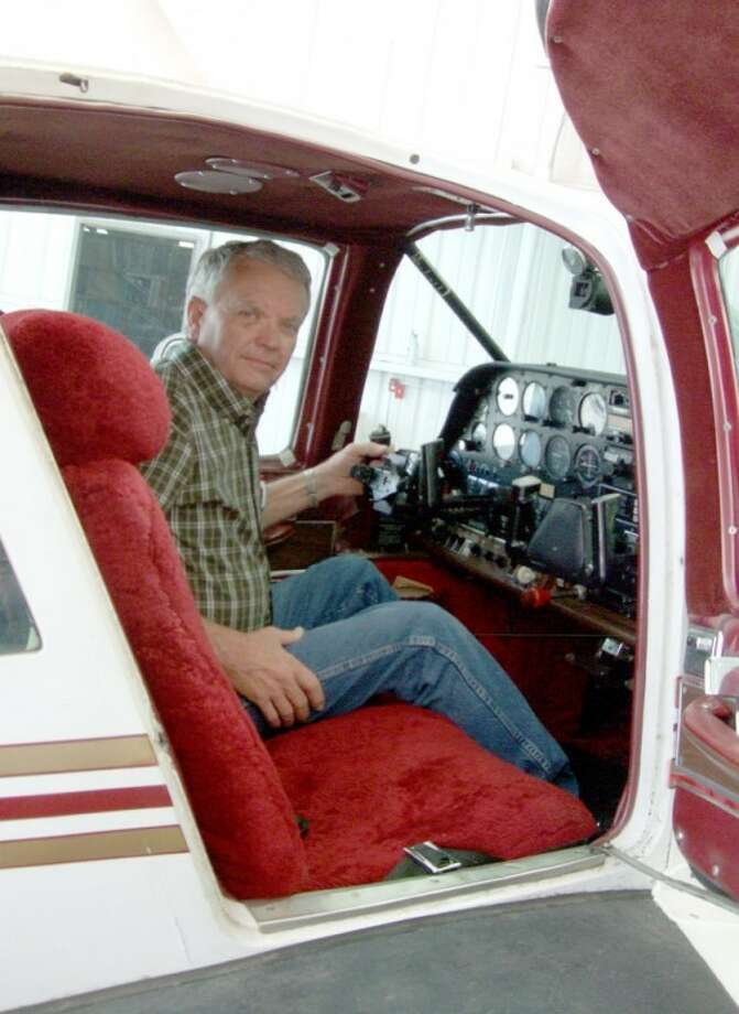 Rocket Aviation Service Manager Dwayne Mitchell sits in a cockpit Wednesday. He's retiring after 40 years. A retirement reception for Mitchell will be held Friday from 2 - 4 p.m. at Rocket Aviation officers. Photo: Shanna Sissom/Plainview Herald