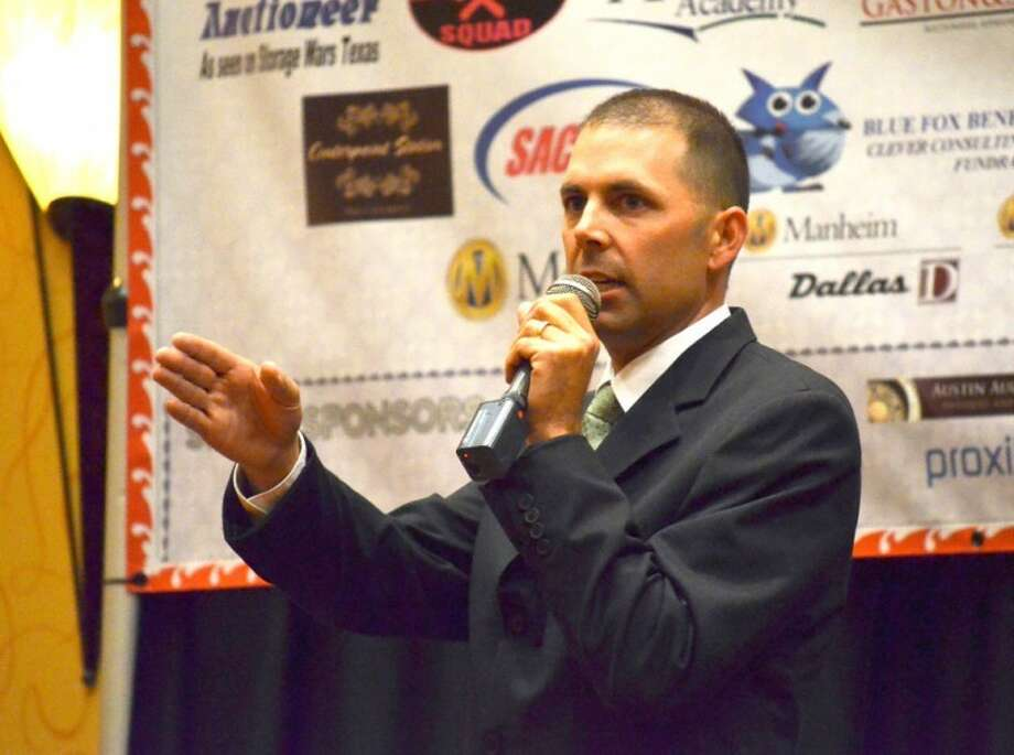 Clay Golden calls for bids Saturday during the finals for Texas State Championship Auctioneer